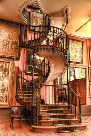 photo of ornate curving wrought iron staircase