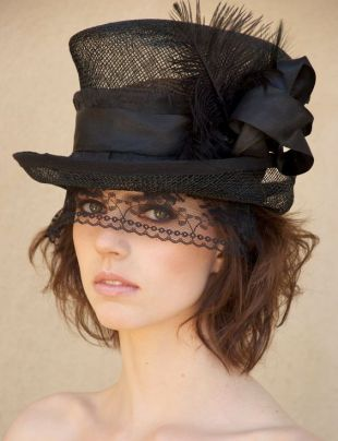 photo of woman's black top hat with lace veil
